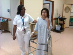 Kastanea Cruz walks on the second day after receiving a T3-L3 fusion at Karl Heusner Memoral Hospital.